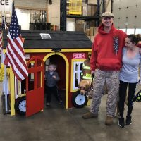 The Brown family with their new playhouse