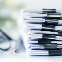 extreamly close up the stacking of office working document with paper clip folder